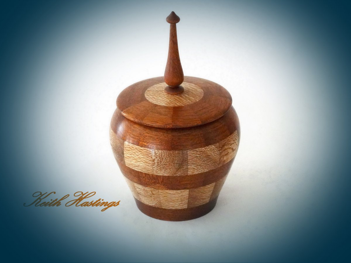 Small lidded bowl turned from Rewa Rewa and Mahogany 90 mm in diameter by 150 mm high.