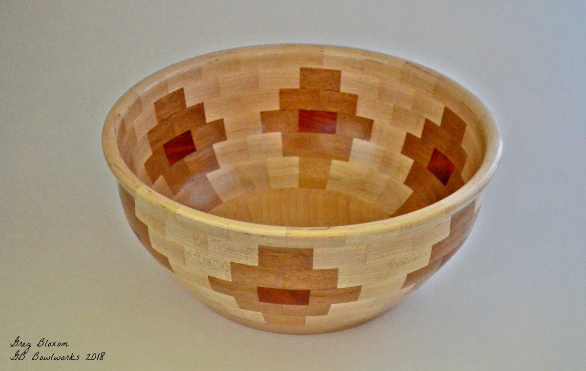 "12"" diameter x 6"" height, 144 segments, Maple, Sapele and Padauk.  Fun to make, and getting faster at making them.  Great gifts."